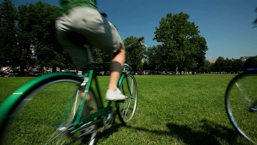 Young couple enjoying cycling through park in summer #4153081