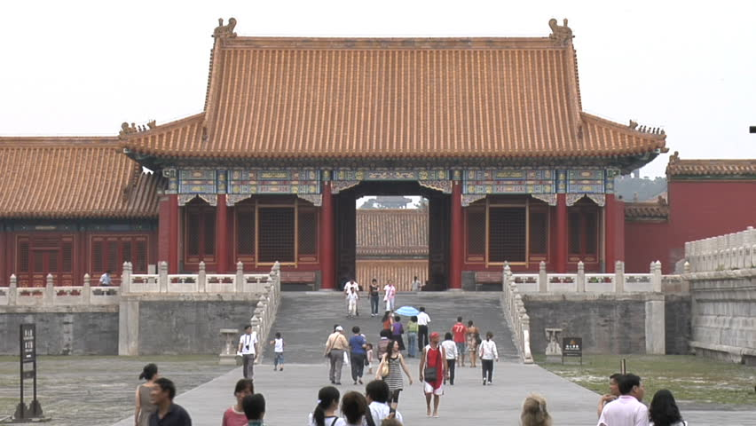BEIJING - MAY 22: Tourists  starting to return to popular vacation spots like Forbidden City in Beijing, China after the world wide recession starts showing signs of recovery.