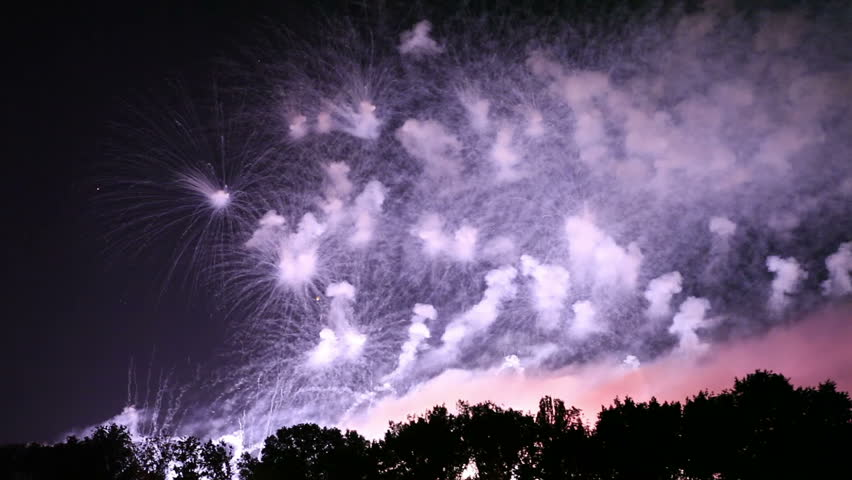 Collage of colorful fireworks exploding in the night sky