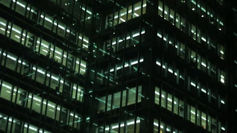 Business building in the night, tilt down & up. Find similar clips in our portfolio.