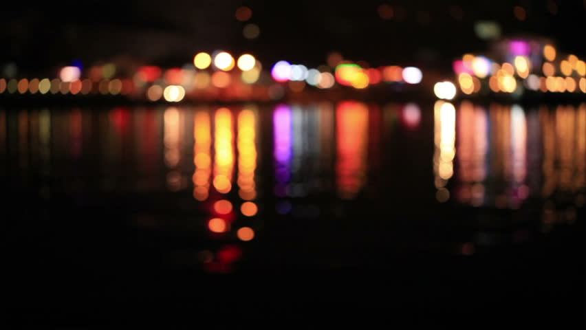 Multicolored defocused lights with reflection on water