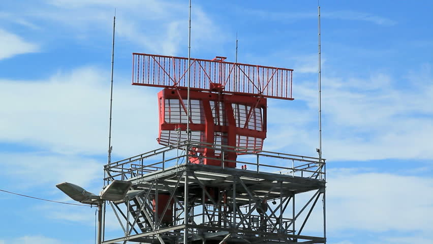 AIRPORT RADAR TOWER.  An airport radar tower in action