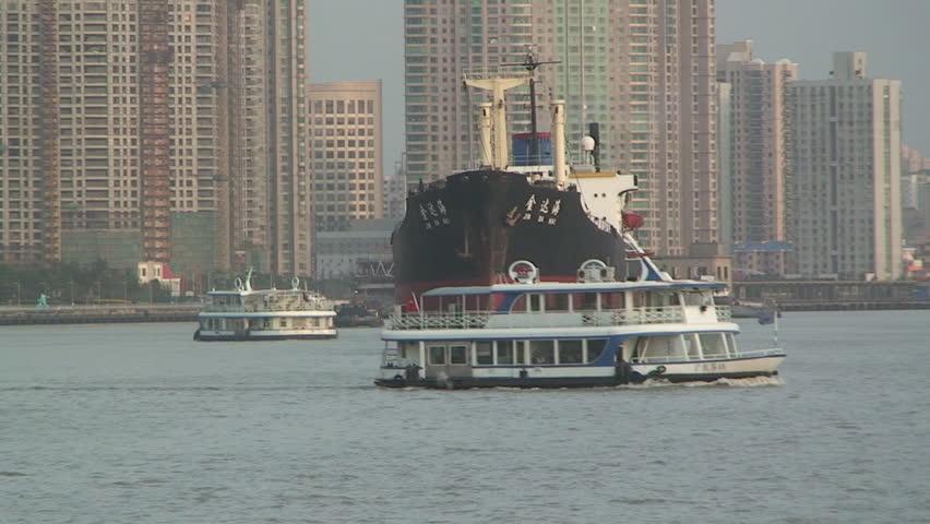 Large ships sail through city