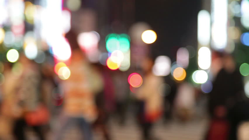 People walking in city night background....