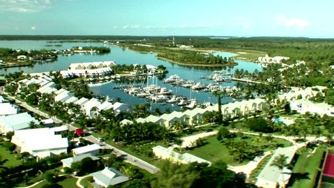 Aerial shot of Bahamas island of Abaco with ocean and marina featured