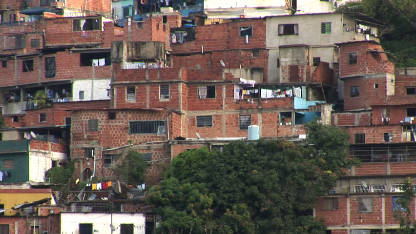 Slums in Caracas with rich condominiums looming overhead