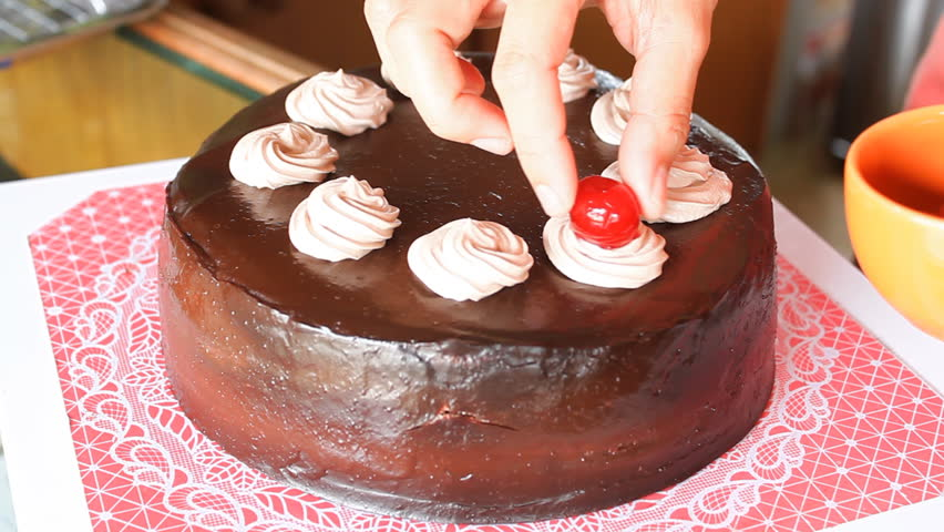 Red cherry topping on chocolate cake