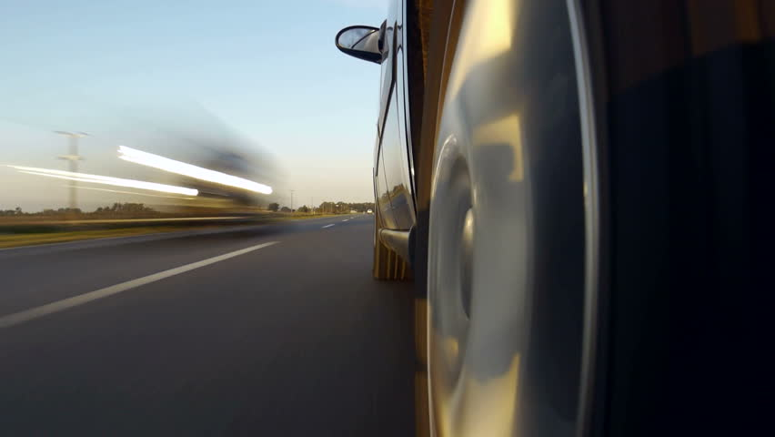 Driving a car on a country road. Wheel spinning POV - Point of View, day country side, sunset, fall / winter. Trees on the side. Fast Speed / time-lapse.