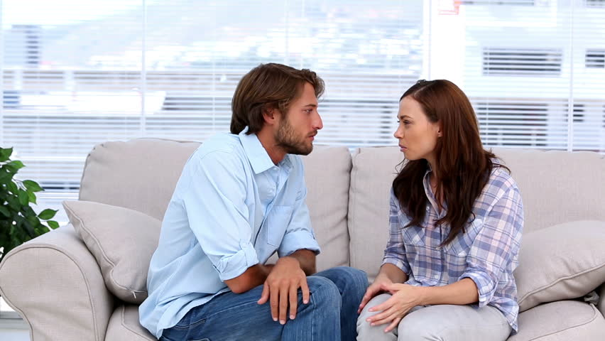 Couple discussing in therapy sitting on a sofa | Shutterstock HD Video #4227481