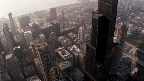 Aerial sunrise view of Willis Tower from high elevation overlooking Downtown District Chicago, Illinois, USA, shot on RED EPIC