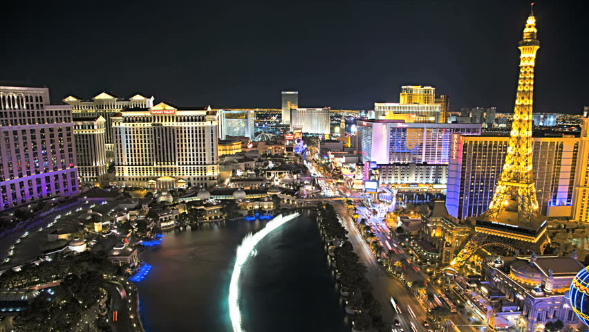 Las Vegas - January 2013: Illuminated view Bellagio Hotel nr Caesars Palace, Las Vegas Strip, USA, Time Lapse | Shutterstock HD Video #4262591