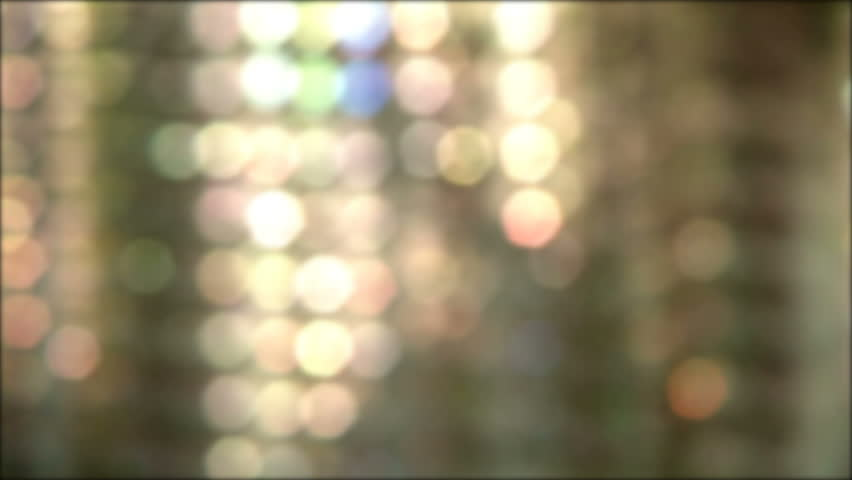 Looping soft light reflection background. Layers of blurred light spots moving slowly from left to right.