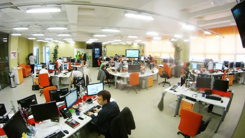 MOSCOW - MAR 05: (timelapse) Office room with people at their desks working and screen at RIA Novosti, on Mar 05, 2013 in Moscow, Russia.