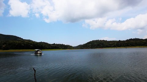 Shot of a tour boat moving in a lake, Periyar Lake, Thekkady, Kerala, India