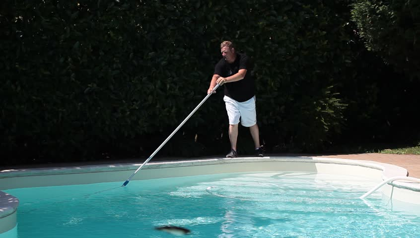 Footage of man cleaning swimming pool.
