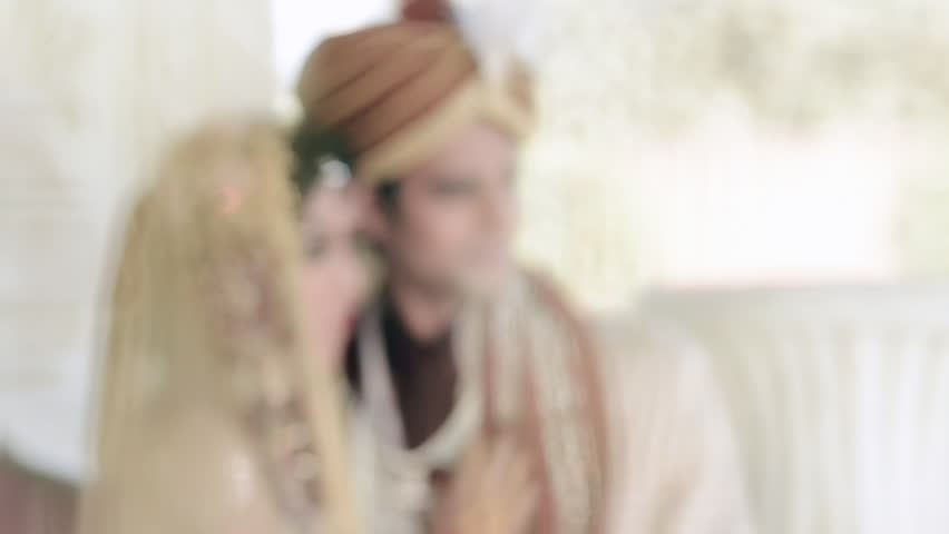 Locked-on shot of Indian bride and groom in traditional wedding dress