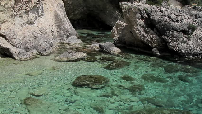 Crystal clear waters at the entrance of sea cave - perfect for scuba diving and snorkeling. Mediterranean island of Lefkada, Greece.