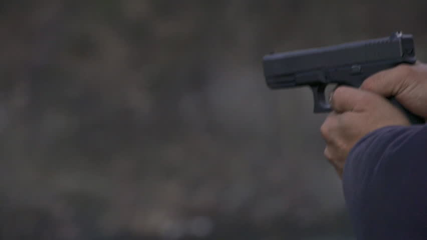 View from left of a man firing a Glock handgun repeatedly, with visible muzzle