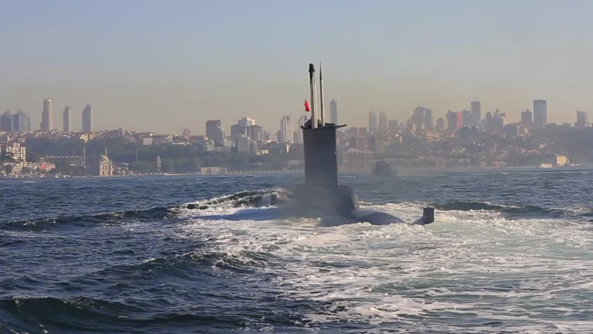 Riding on the wake of the submarine. Navy Submarine moving into Bosporus waters.