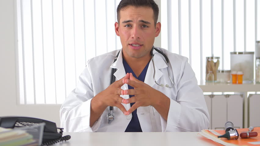 Hispanic Doctor Talking To Camera Stock Footage Video 100 -6231
