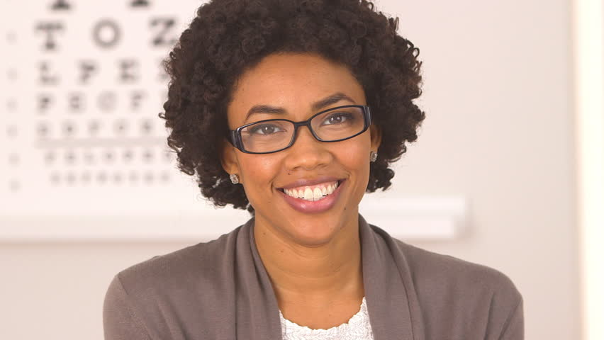 African American woman happy with new glasses at eye doctor #4378181