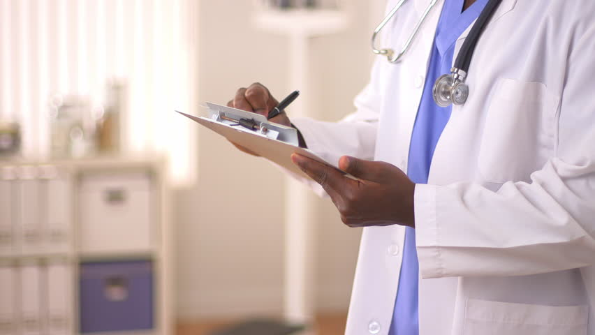 Close up of African American Doctor's hands writing on chart   Shutterstock HD Video #4378508