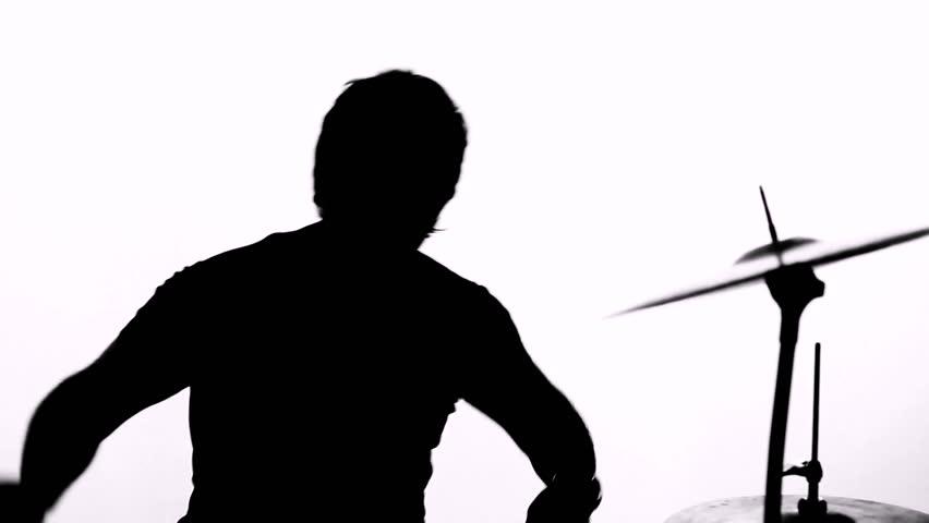 Rock drummer in silhouette performing