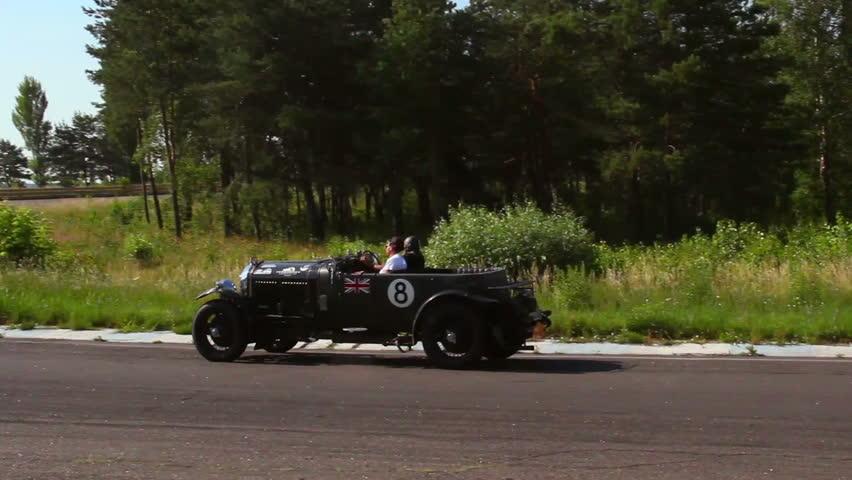 KIEV, UKRAINE - JUNE 22: International Rally Peking to Paris 2013. Bentley 4 1 2 with Britain Flag, vintage car rally | Shutterstock HD Video #4402811
