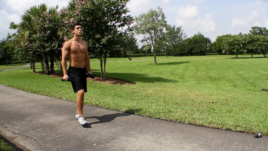 HD: man stretching outdoors - lunge. front view.