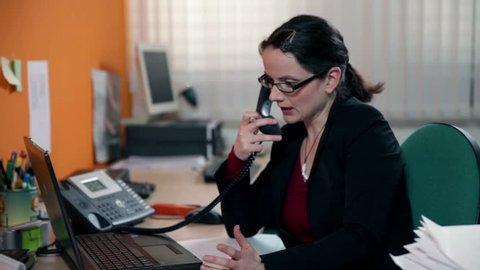 Close up business woman making a call at work