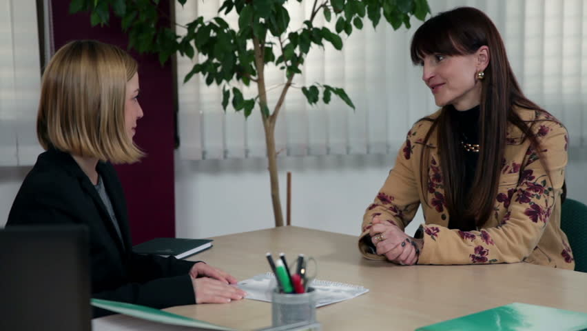 Medium shot of CEO and interviewee conversation | Shutterstock HD Video #4445801