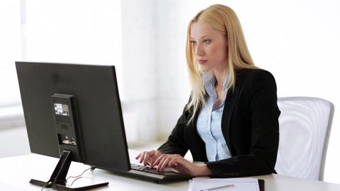 attractive business woman working with computer in office