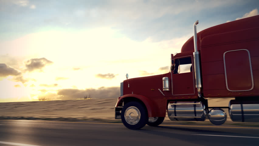 18 Wheel Truck On The Road With Sunset In The Background. Large Delivery  Truck Is