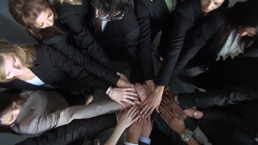 Business group put their hands together for team talk. High quality HD video footage