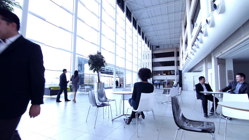 Large office team time lapse. People shaking hands in office foyer reception.
