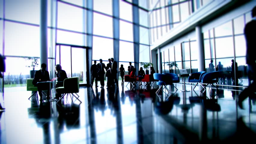 Large multi ethnic business group in relaxed meeting area of a large contemporary corporate building. High quality HD video footage | Shutterstock HD Video #4479587