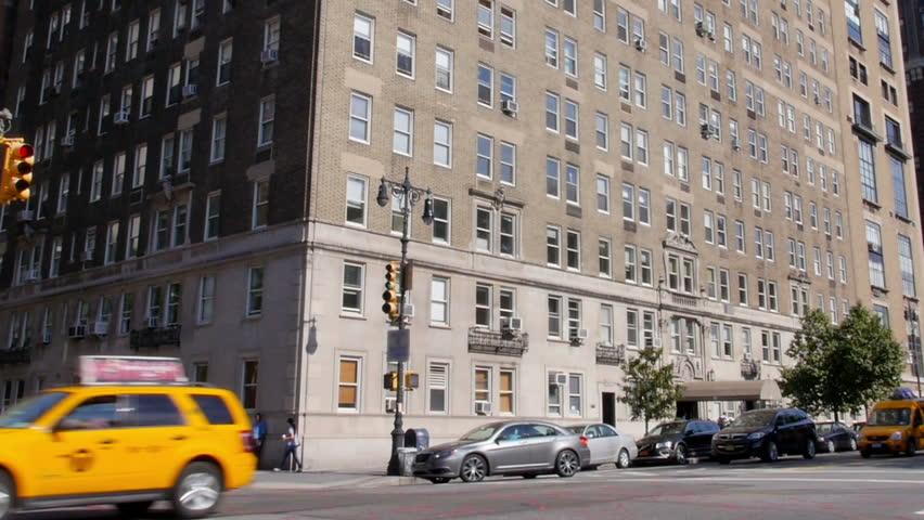 A typical daytime New York City apartment building establishing shot.