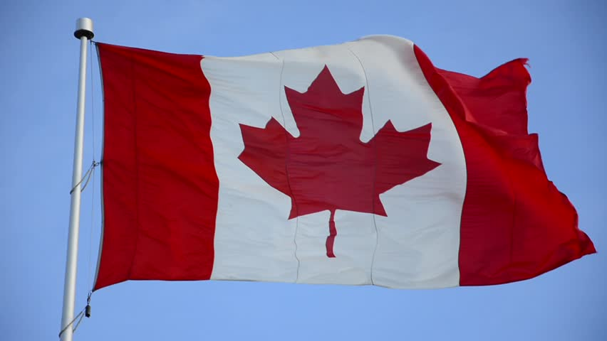 Canadian Flag or the Flag of Canada waving on a windy day. Red and White, the colors of the Maple Leaf