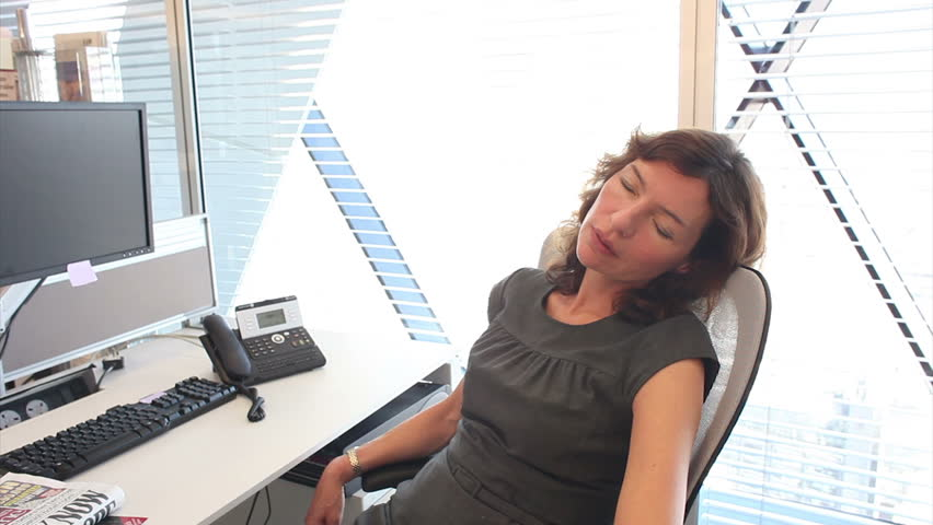 Funny scene wityh sleeping office workers. Natural and realistic office setting with relaxed team - too relaxed!