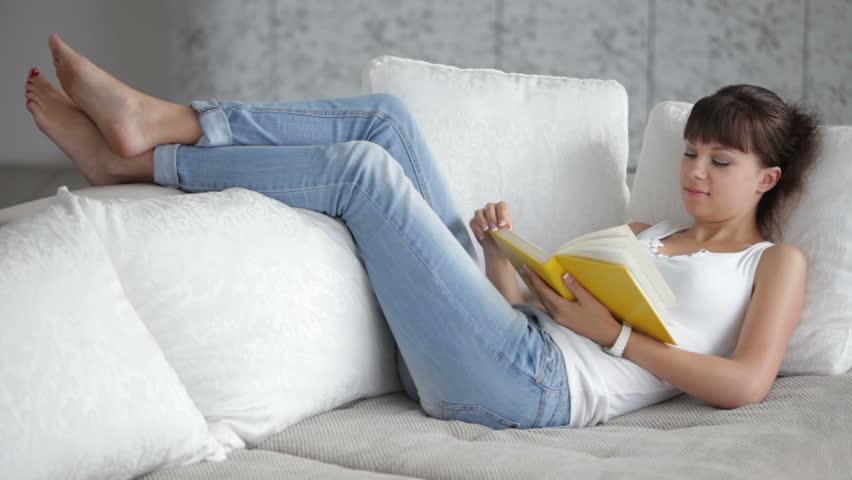 e99a8526ba43 Young Woman Relaxing On Sofa Vidéos de stock (100 % libres de ...