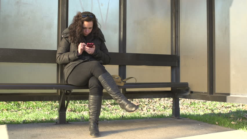 Female waiting at bus stop