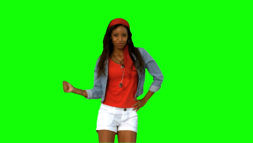 Woman dancing on green screen in slow motion
