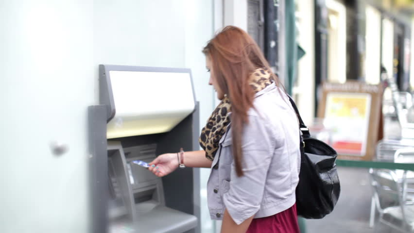 Girl takes money out of an ATM | Shutterstock HD Video #4536017