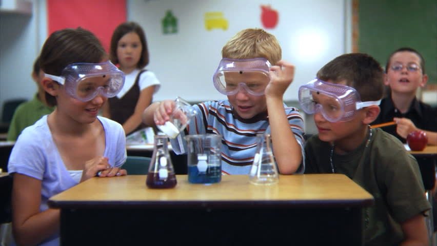 Elementary school students doing a science experiment