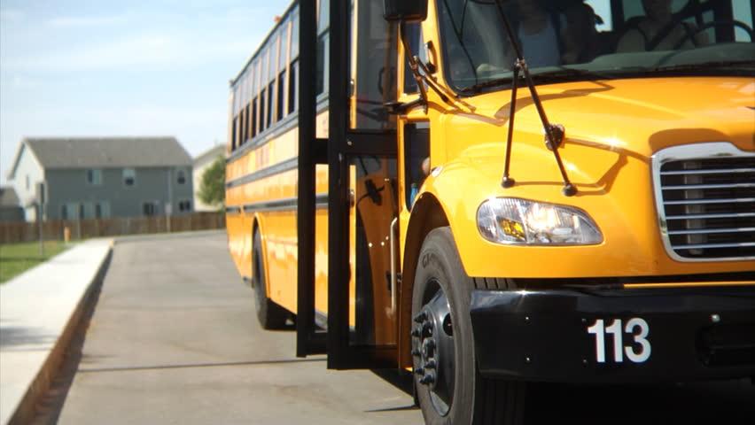 Students getting off school bus | Shutterstock HD Video #4541231