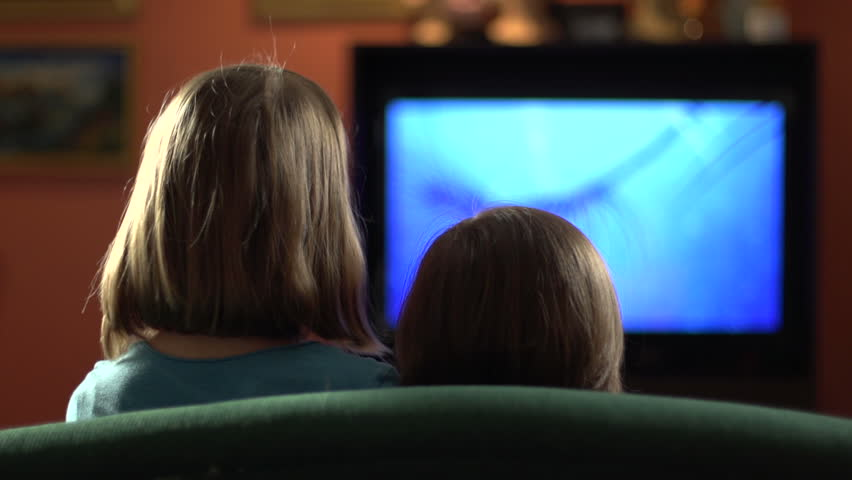 Sisters on the couch watching television   Shutterstock HD Video #4541396