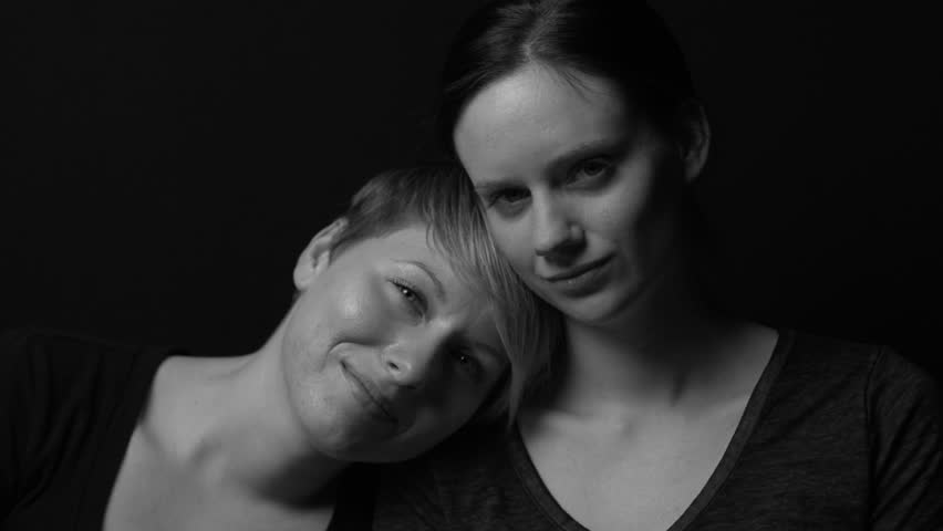 Black and white portrait of a female couple, moving light