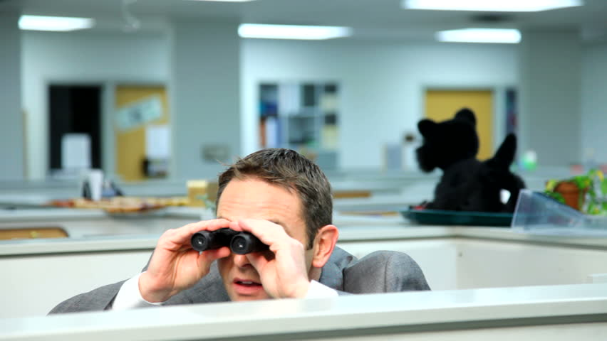 Businessman peeking over cubicle with binoculars - HD stock video clip