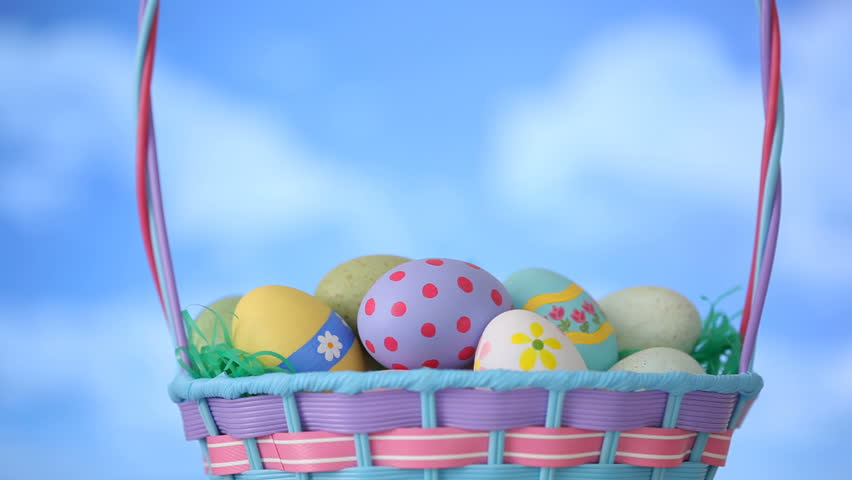 Animation of painted easter eggs in a basket seamless looping hd clouds move by easter basket hd stock footage clip negle Gallery