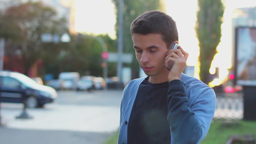 Man calls dials number no answer serious young male outdoors day